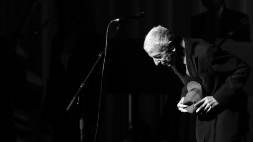 Leonard Cohen takes a bow as he takes the stage for his performance in Toronto on Friday, June 6, 2008. (AP Photo/The Canadian Press, Aaron Harris)